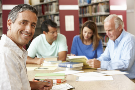 qualifications: Mature students working in library Stock Photo