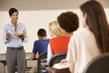 boy 15 year old: African American teacher teaching at front of class