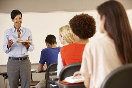 African American teacher teaching at front of class
