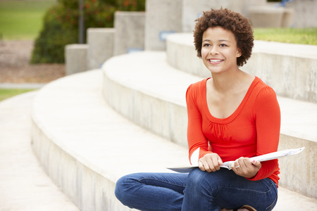 mixed race: Mixed race student working outdoors