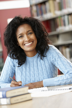 late forties: Mature student working in library Stock Photo
