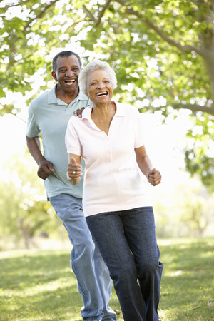 african american couple: Senior African American Couple Running In Park