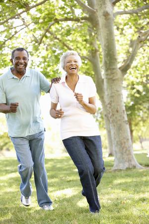 senior african: Senior African American Couple Running In Park