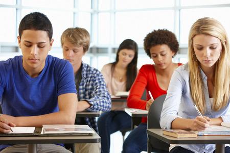 working class: Multi racial teenage pupils in class Stock Photo
