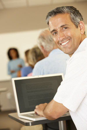 Mature student in class Banque d'images