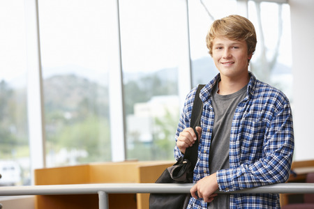 one teenager: Teenage student boy indoors Stock Photo
