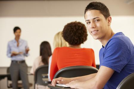 15 year old: Teenage Hispanic boy in class smiling to camera