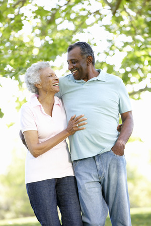 countryside loving: Romantic Senior African American Couple Walking In Park