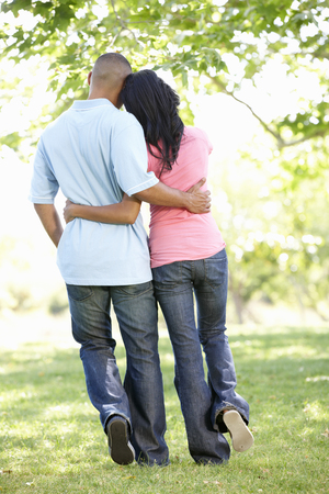 african american couple: Romantic Young African American Couple Walking In Park Stock Photo