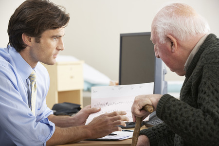 30s adult: Doctor talking to senior male patient