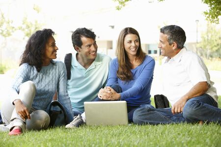 laptop outside: People using laptop outdoors Stock Photo