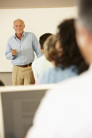the elderly tutor: Teacher and mature students in class
