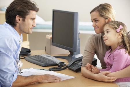 general practice: Doctor talking to mother and child