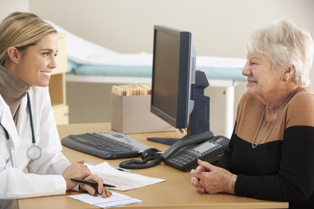 female doctor: Doctor talking to senior woman patient Stock Photo