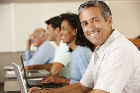 qualifications: Mature student in class Stock Photo