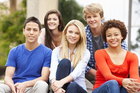 racial: Multi racial student group sitting outdoors