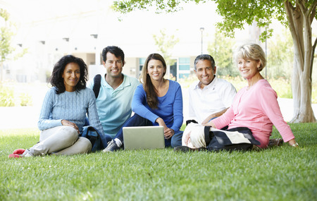 laptop outside: Mature students outdoors Stock Photo