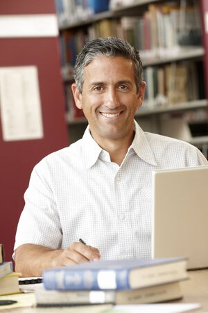adult student: Mature student working in library Stock Photo