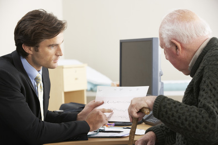 patient notes: Doctor talking to senior male patient