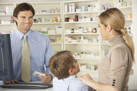 mummy: Pharmacist in pharmacy with mother and child