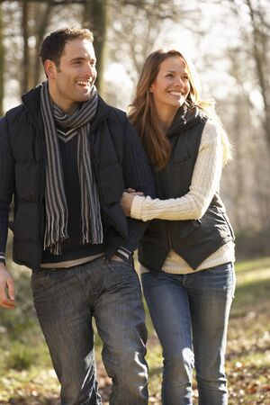 walk in: Couple on romantic walk in winter
