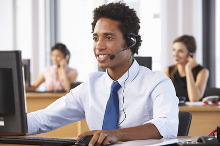 telephone headsets: Friendly Customer Service Agent In Call Centre