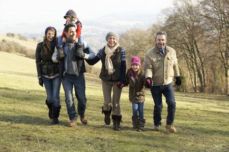 3 Generation family on country walk in winter Archivio Fotografico