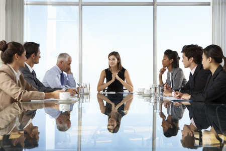 Group Of Business People Having Board Meeting Around Glass Table Stock Photo - 42163702