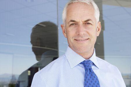 mature businessman: Mature Businessman Standing Outside Modern Office Stock Photo