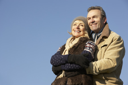 mature adult: Portrait mature couple outdoors in winter Stock Photo