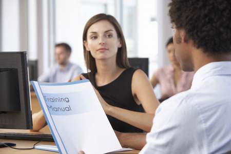 employee: New Employee Starting Work In Busy Office Stock Photo