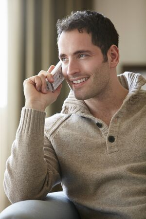 cordless: Young man talking on cordless phone at home Stock Photo