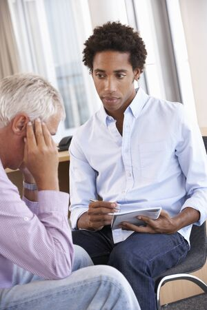 two men: Middle Aged Man Having Counselling Session