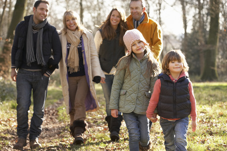 6 7 year old: 3 Generation family on country walk in winter Stock Photo