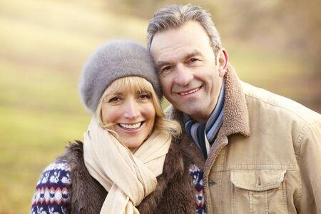 fall winter: Portrait senior couple outdoors in winter Stock Photo