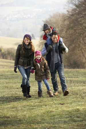 walk in: Family on country walk in winter