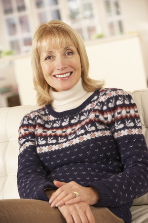 woman sweater: Portrait mature woman relaxing at home