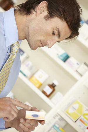 nhs: UK pharmacist working in pharmacy