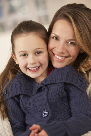 7 year old girl: Portrait mother and daughter at home Stock Photo