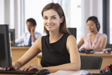 man office: Smiling Worker In Busy Office