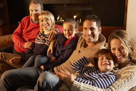 6 7 year old: Portrait 3 generation family at home by firelight Stock Photo