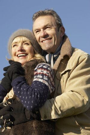 couple winter: Portrait mature couple outdoors in winter Stock Photo