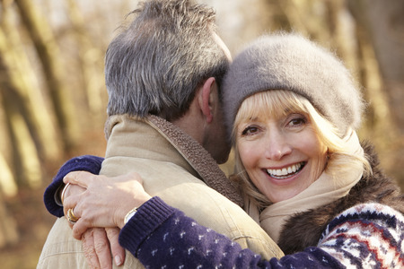 couple winter: Senior couple hugging outdoors in winter