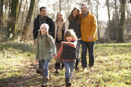 granny and grandad: 3 Generation family on country walk in winter Stock Photo