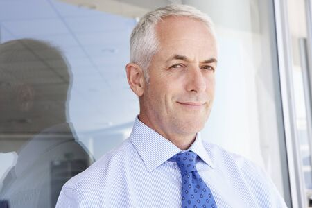 one mid adult male: Mature Businessman Standing Outside Modern Office Stock Photo