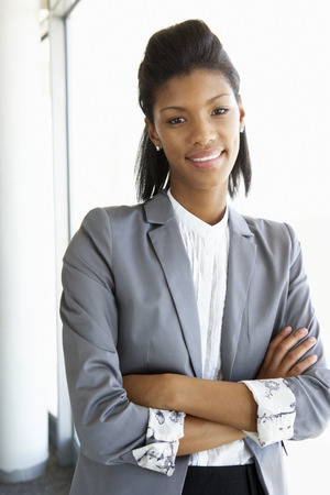 african business: Young Businesswoman Standing In Corridor Of Modern Office Building Stock Photo