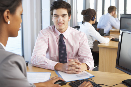 busy  office: New Employee Starting Work In Busy Office Stock Photo