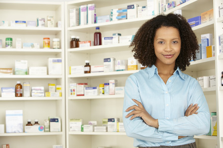 shelves: Female pharmacist working in UK pharmacy