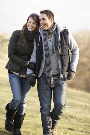 winter couple: Couple on romantic country walk in winter Stock Photo