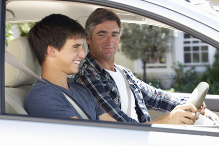 teens: Father Teaching Teenage Son To Drive